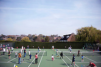 Parents and their children warm up for a coaching session with Dan Bloxham, Head Coach, as part of the Junior Tennis initiative at Wimbledon, The All England Lawn Tennis Club (AELTC), London...