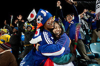 Japanese fans celebrate Japan's victory against Denmark  at the Royal Bafokeng Stadium during 2010 World Cup first round match in Rustenberg, South Africa on Thursday, June 24, 2010.