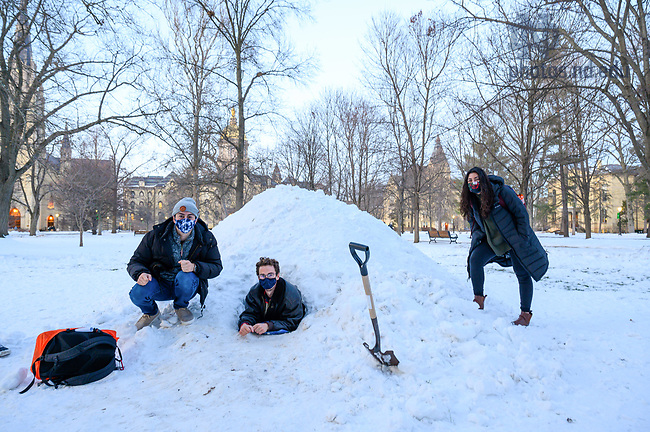 February 3, 2021; Students pose next to and in a makeshift igloo on Main Quad. (Photo by Matt Cashore/University of Notre Dame)
