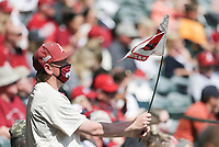 An Arkansas fan waves a flag, Saturday, April 3, 2021 during the fifth inning of a baseball game at Baum-Walker Stadium in Fayetteville. Check out nwaonline.com/210404Daily/ for today's photo gallery. <br /> (NWA Democrat-Gazette/Charlie Kaijo)
