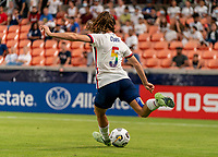 HOUSTON, TX - JUNE 10: Kelley O'Hara #5 of the USWNT punts the ball during a game between Portugal and USWNT at BBVA Stadium on June 10, 2021 in Houston, Texas.