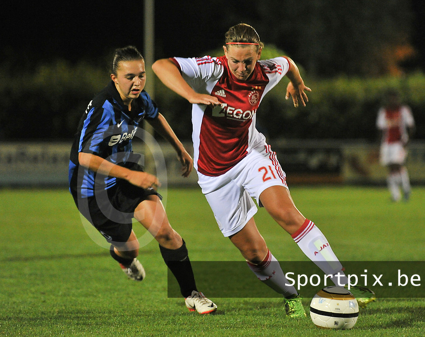 20130830 - VARSENARE , BELGIUM : Ajax' Chantal De Ridder (right) pictured being followed by Brugge's Jody Vangheluwe (left) during the female soccer match between Club Brugge Vrouwen and Ajax Amsterdam Dames , of the first matchday in the BENELEAGUE competition. Friday 30 August 2013. PHOTO DAVID CATRY