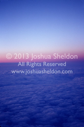 Clouds and sunset viewed from airplane window<br />