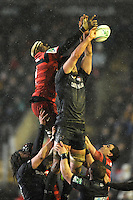 Yannick Nyanga of Stade Toulousain jumps against Geoff Parling of Leicester Tigers in the lineout during the Heineken Cup 6th round match between Leicester Tigers and Stade Toulousain at Welford Road on Sunday 20th January 2013 (Photo by Rob Munro).