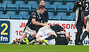 Dundee's David Clarkson is mobbed by team mates after he scores their late winning goal.