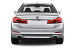 Straight rear view of a 2018 BMW 5 Series Plug-In Hybrid 530e Sport 4 Door Sedan stock images