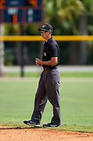 Umpire Takashi Wada during a game between the FCL Yankees and FCL Tigers West on July 31, 2021 at Tigertown in Lakeland, Florida.  (Mike Janes/Four Seam Images)