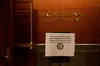 """A sign advising members and staffers to wear face masks is seen outside a room where a United States House Judiciary committee hearing on """"Oversight of the Department of Justice: Political Interference and Threats to Prosecutorial Independence"""" is being held on Capitol Hill in Washington DC on June 24th, 2020.<br /> Credit: Anna Moneymaker / Pool via CNP/AdMedia"""