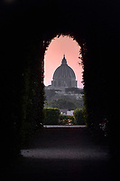 Rome Colle Aventino, The keyhole of the Villa del Priorato di Malta perfectly frames the dome of St. Peter's Basilica. A decidedly unusual and exciting perspective game: there are in fact those who point out that it is the only lock in the world from which you can see another state, namely the Vatican, even if on Italian soil, through the door of a villa that enjoys the right of extra territoriality. This is in fact the institutional seat of the Order of the Grand Priory of Rome of the Knights of Malta (now known as the Sovereign Military Order of Malta). A fortified Benedictine monastery once stood in this place, strategically located on the bend of the Tiber and passed into the hands of the Knights Templar. After the suppression of the order, it became the property of another chivalric religious order, the Knights Hospitallers.<br />  <br /> Several dynasties succeeded each other in the possession of this place, which, over time, had been restored and from a monastery had become a Renaissance complex. But it was thanks to Cardinal Giovanni Battista Rezzonico that in 1765 the Rococo-style entrance square was built, sumptuously decorated with coats of arms and trophies. The majestic entrance door to the square is the one from which you can 'spy' St. Peter's in the distance.