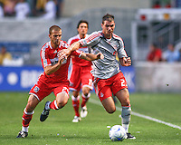 Toronto FC forward Jarrod Smith (23) fights to keep control of the ball against Chicago Fire defender Daniel Woolard (24) , attempts a shot on goal against the Chicago Fire.  Chicago Fire defeated Toronto FC by the score of 2-1 at Toyota Park stadium, in Bridgeview, Illinois on Saturday, July 12, 2008.