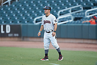 Birmingham Barons strength coach Tim Rodmaker (1) coaches first base during the Southern League game against the Pensacola Blue Wahoos at Regions Field on July 7, 2019 in Birmingham, Alabama. The Barons defeated the Blue Wahoos 6-5 in 10 innings. (Brian Westerholt/Four Seam Images)