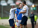 St Johnstone v Rangers...14.01.12  .Liam Craigf squares up to Kyle Bartley and Sone Aluko.Picture by Graeme Hart..Copyright Perthshire Picture Agency.Tel: 01738 623350  Mobile: 07990 594431