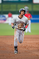 Luke Tendler (18) of the Hickory Crawdads rounds the bases after hitting a home run against the Kannapolis Intimidators at CMC-Northeast Stadium on April 17, 2015 in Kannapolis, North Carolina.  The Crawdads defeated the Intimidators 9-5 in game one of a double-header.  (Brian Westerholt/Four Seam Images)
