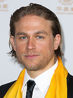 HOLLYWOOD, LOS ANGELES, CA, USA - JUNE 01: Actor Charlie Hunnam poses with the award for Best Global Emerging Actor in the press room at the 12th Annual Huading Film Awards held at the Montalban Theatre on June 1, 2014 in Hollywood, Los Angeles, California, United States. (Photo by Xavier Collin/Celebrity Monitor)