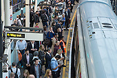 London rush hour passengers and trains at Farringdon underground station