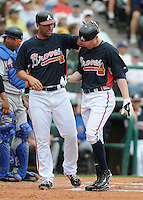17 March 2009: Josh Anderson of the Atlanta Braves, right, is congratulated by Jeff Francoeur after hitting a home run in a game against the New York Mets at the Braves' Spring Training camp at Disney's Wide World of Sports in Lake Buena Vista, Fla. Photo by:  Tom Priddy/Four Seam Images