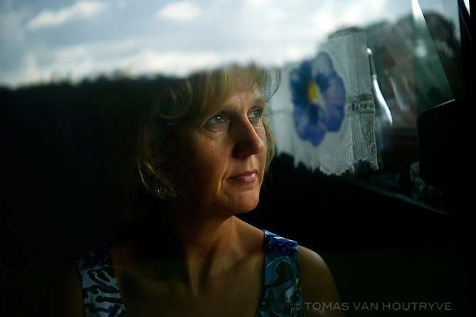 Linda Opdebeeck, 46, who was sexually abused by a brother of the Marist order at her Catholic school in Oudergem for several years starting when she was 13 poses for a portrait at her home in, Hoeilaart, Belgium on Sept. 17, 2010. This week, church investigators published an explosive report on 475 claims of sexual abuse over a 50-year time span, with harrowing tales from almost every congregation in the country about priests raping and assaulting young parishioners.