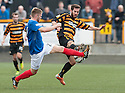 Cowdenbeath's Marcus Fraser and Alloa's Liam Buchanan challenge for the ball.