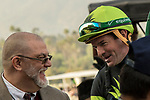 ARCADIA, CA  DECEMBER 26: Kent Desormeaux shares a laugh with Clerk of Scales Kevin Colusi, after winning the Mathis Brothers Mile (Grade ll) with #5 Bowies Hero on December 26, 2017 at Santa Anita Park in Arcadia, CA.(Photo by Casey Phillips/ Eclipse Sportswire/ Getty Images)