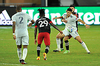 WASHINGTON, DC - SEPTEMBER 27: Matt Polster #8 of New England Revolution battles for the ball with Junior Moreno #5 of D.C. United during a game between New England Revolution and D.C. United at Audi Field on September 27, 2020 in Washington, DC.