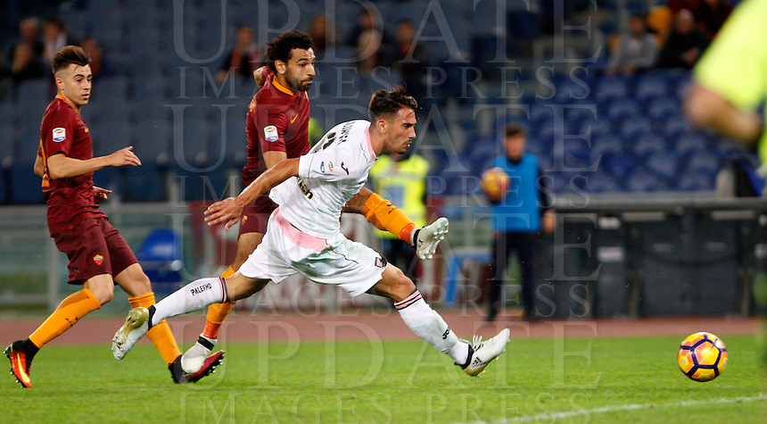 Calcio, Serie A: Roma vs Palermo. Roma, stadio Olimpico, 23 ottobre 2016.<br /> Roma's Mohamed Salah, center, kicks to score as Palermo's Edoardo Goldaniga, right, tries to stop him during the Italian Serie A football match between Roma and Palermo at Rome's Olympic stadium, 23 October 2016. Roma won 4-1.<br /> UPDATE IMAGES PRESS/Riccardo De Luca