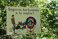 "Sign at Zoo Ave, a zoo near San Jose, Costa Rica, specializing in native birds, promotes rainforest conservation with the slogan ""Will you keep torturing your mother?"""