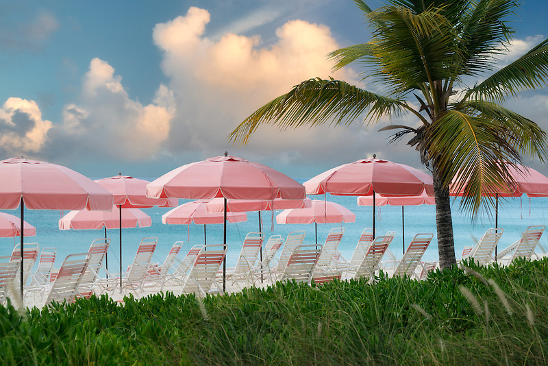 Pink beach umbrellas and chairs. Turks and Caicos. Providenciales.
