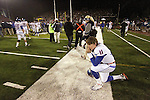 Boise State Broncos quarterback Kellen Moore on the sidelines after losing to Nevada 34-31 in the NCAA college football game Friday night, Nov. 26, 2010, in Reno, Nev. (AP Photo/Cathleen Allison)