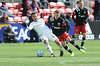 WASHINTON, DC - FEBRUARY 29: Washington, D.C. - February 29, 2020: Andre Shinyashiki #99 of the Colorado Rapids battles the ball with Russell Canouse #4 of D.C. United. The Colorado Rapids defeated D.C. United 2-1 during their Major League Soccer (MLS)  match at Audi Field during a game between Colorado Rapids and D.C. United at Audi FIeld on February 29, 2020 in Washinton, DC.