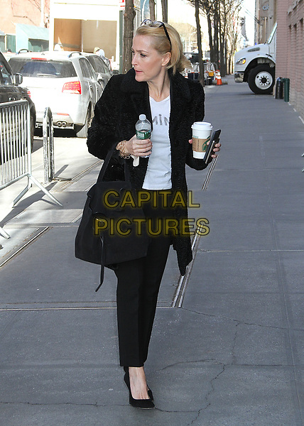 """NEW YORK, NY - MARCH 13:  Gillian Anderson spotted arriving at 'The View' to promote her book  """"We: A Manifesto For Women Everywhere""""  in New York, New York on March 13, 2017.  <br /> CAP/MPI/RMP<br /> ©RMP/MPI/Capital Pictures"""