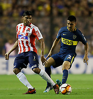 "BUENOS AIRES - ARGENTINA - 04 - 04 - 2018: Paolo Goltz (Der.) jugador de Boca Juniors disputa el balón con Luis Carlos Ruiz (Izq.) jugador de Atletico Junior, durante partido de la fase de grupos, grupo H, fecha 2, entre Boca Juniors (ARG) y Atletico Junior (Col) por la Copa Conmebol Libertadores 2018, jugado en el estadio Alberto J. Armando ""La Bombonera""  de la ciudad Ciudad Autónoma de Buenos Aires. / Paolo Goltz (R) player of Boca Juniors vies for the ball with Luis Carlos Ruiz (L) player of Atletico Junior, during a match of the groups phase, group H, of the 2nd date between Boca Juniors (ARG) and Atletico Junior (Col), for the Copa Conmebol Libertadores 2018 at the Alberto J. Armando ""La Bombonera"" Stadium in Ciudad Autónoma de Buenos Aires. Photo: VizzorImage / Javier Garcia Martino / Photogamma / Cont."