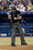 Home plate umpire Mike Winters makes a call during a game between the Toronto Blue Jays and Boston Red Sox at Rogers Centre on June 3, 2012 in Toronto, Ontario.  (Mike Janes/Four Seam Images)
