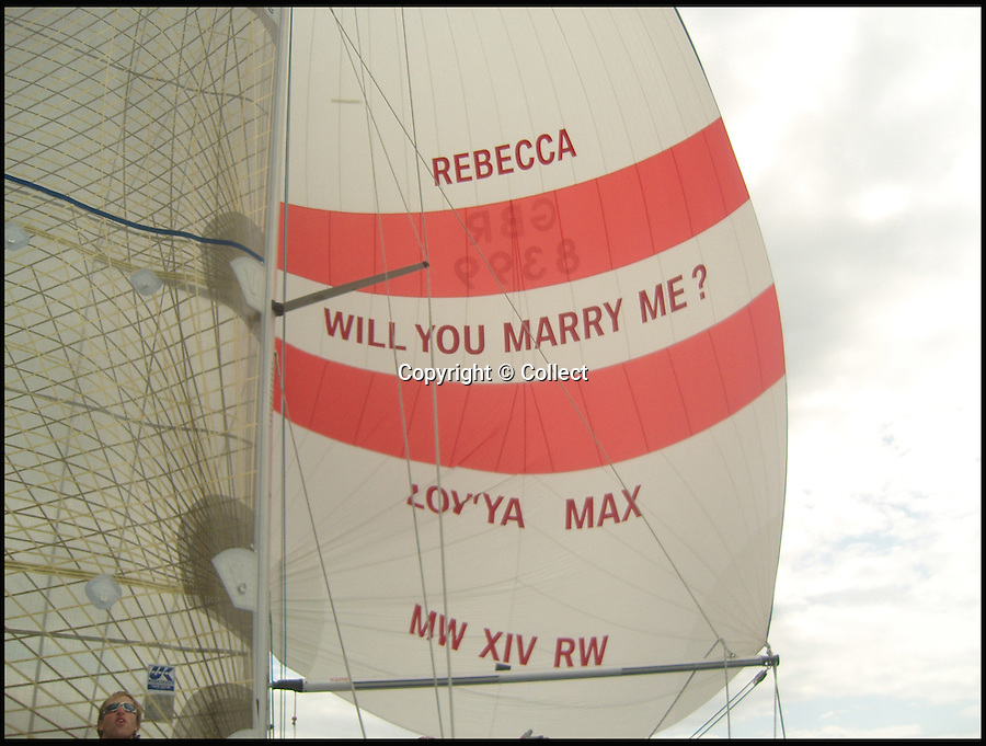 BNPS.co.uk (01202 558833)<br /> Pic: Collect<br /> <br /> Max Walker proposed to Rebecca Vowles using the sail of their boat during the Round the Island Race in 2009.<br /> <br /> The wife of a millionaire businessman who was proposed to in a flashy yachting stunt has been slapped with a restraining order against him after their relationship hit the rocks. <br /> <br /> Rebecca Vowles 'publicly humiliated' former husband Max Walker after posting an abusive rant questioning his parenting skills on Facebook.<br /> <br /> It had looked like plain sailing for the couple after he popped the question to her by stitching the words 'will you marry me?' onto a sail on his plush 38ft sailing boat during a race in 2009.<br /> <br /> The couple moved into a £2 million pound coastal pad in Poole, Dorset, ran a company selling discount goods online and had two children together.<br /> <br /> But just three years later their relationship turned stormy and they split up, kickstarting a string of bitter civil court clashes.