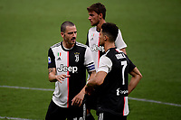 Leonardo Bonucci and Cristiano Ronaldo of Juventus during the Serie A football match between AC Milan and Juventus FC at stadio San Siro in Milan ( Italy ), July 7th, 2020. Play resumes behind closed doors following the outbreak of the coronavirus disease. <br /> Photo Federico Tardito / Insidefoto