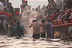 Hindu pilgrims brave the cold dawn temperatures and bathe in the holy waters of the Ganges River to cleanse them of sin and free them from the cycle of rebirth.