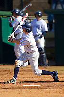Blake Houston #3 of the Catawba Indians follows through on his swing against the Shippensburg Red Raiders at Newman Park on February 12, 2011 in Salisbury, North Carolina.  Photo by Brian Westerholt / Four Seam Images