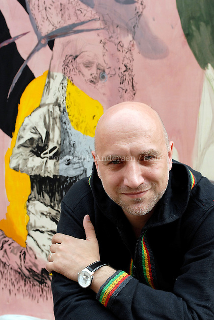Russian writer Zakhar Prilepine poses during portrait session in front of a painting by Fiona Valentine Thomann, held on May 31, 2012  in Lyon, France.