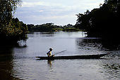 Pantanal, Mato Grosso State, Brazil; fisherman in a dugout canoe in the middle of the river.