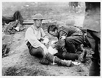 With the Canadians in the great battle<br /> Description<br /> <br /> The Red Cross man does his bit in the fight by dressing a Canadian