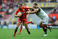 Charlie Hodgson of Saracens is tackled by Maurie Fa'asavalu of Harlequins during the Aviva Premiership match between Saracens and Harlequins at Wembley Stadium on Saturday 31st March 2012 (Photo by Rob Munro)