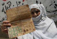 "Palestinian woman  Rasmia Al-akaras 78 years presented a paper proving the ownership of the house in Wadi Hanin Village beside  Beersheba  in the occupied territories in 1948 in the 59 anniversary of the catastrophe 15.May.2007.""photo by Fady Adwan"""