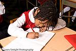Parochial School Bronx New York  Kindergarten closeup of girl writing in notebook with pencil horizontal