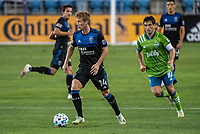 SAN JOSE, CA - OCTOBER 18: Jackson Yueill #14 of the San Jose Earthquakes out paces Nicolas Lodeiro #10 of the Seattle Sounders during a game between Seattle Sounders FC and San Jose Earthquakes at Earthquakes Stadium on October 18, 2020 in San Jose, California.