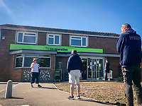 Queues outside a local CO-OP store during Easter bank holiday Monday during the Covid-19 Pandemic as the UK Government advice to maintain social distancing and minimise time outside in High Wycombe on 13 April 2020. Photo by PRiME Media Images.
