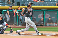 Raimel Tapia (2) of the Albuquerque Isotopes follows through on his swing against the Salt Lake Bees during the Pacific Coast League game at Smith's Ballpark on August 29, 2016 in Salt Lake City, Utah. The Isotopes defeated the Bees 9-4. (Stephen Smith/Four Seam Images)