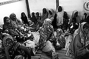 Women seen with their malnutritioned children inside a stabilization centre where the children are given plumpy nut supplement in IFO-1camp in the Dadaab refugee camp in northeastern Kenya. Photo: Sanjit Das/Panos