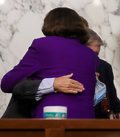 United States Senator Lindsey Graham (Republican of South  Carolina), Chairman, US Senate Judiciary Committee and United States Senator Dianne Feinstein (Democrat of California), Ranking Member, US Senate Judiciary Committee, hug at the conclusion of the fourth day of the confirmation hearing for Judge Amy Coney Barrett, President Donald Trump's Nominee for Supreme Court, in Hart Senate Office Building in Washington DC, on October 15th, 2020.<br /> Credit: Jonathan Ernst / Pool via CNP /MediaPunch