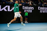 8th February 2021; Melbourne, Victoria, Australia;  Novak Djokovic of Serbia returns the ball during round 1 of the 2021 Australian Open on February 8 2020, at Melbourne Park in Melbourne, Australia.