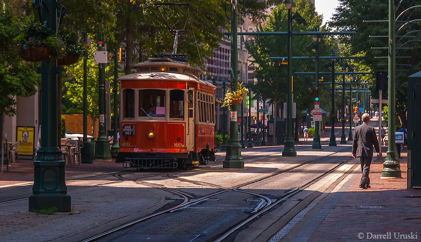 Urban Street of Memphis Tennessee, Street Photograph of the trolley lines in downtown Memphis.<br /> The city is located on the confluence of the Wolf and Mississippi rivers. Downtown Memphis and metro area spread out through suburbanization, and encompass southwest Tennessee, northern Mississippi and eastern Arkansas. Several large parks were founded in the city in the early 20th century