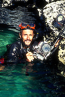 Underwater photographer Jack Grove in the Galapagos. Photo credits to Jim Woodman; Copyright J.S. Grove Photography, portrait. Underwater photographer Jack Grove. South James Bay, Santiago Isl. Galapagos Islands Ecuador Pacific Ocean, 650 miles west of S.